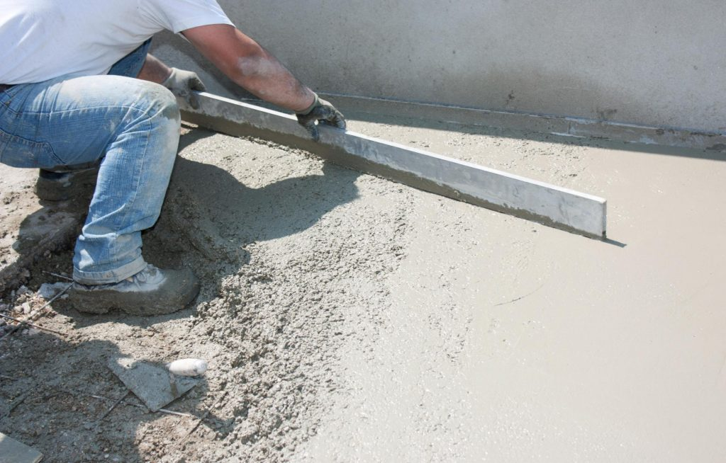 concrete and masonry worker building driveway