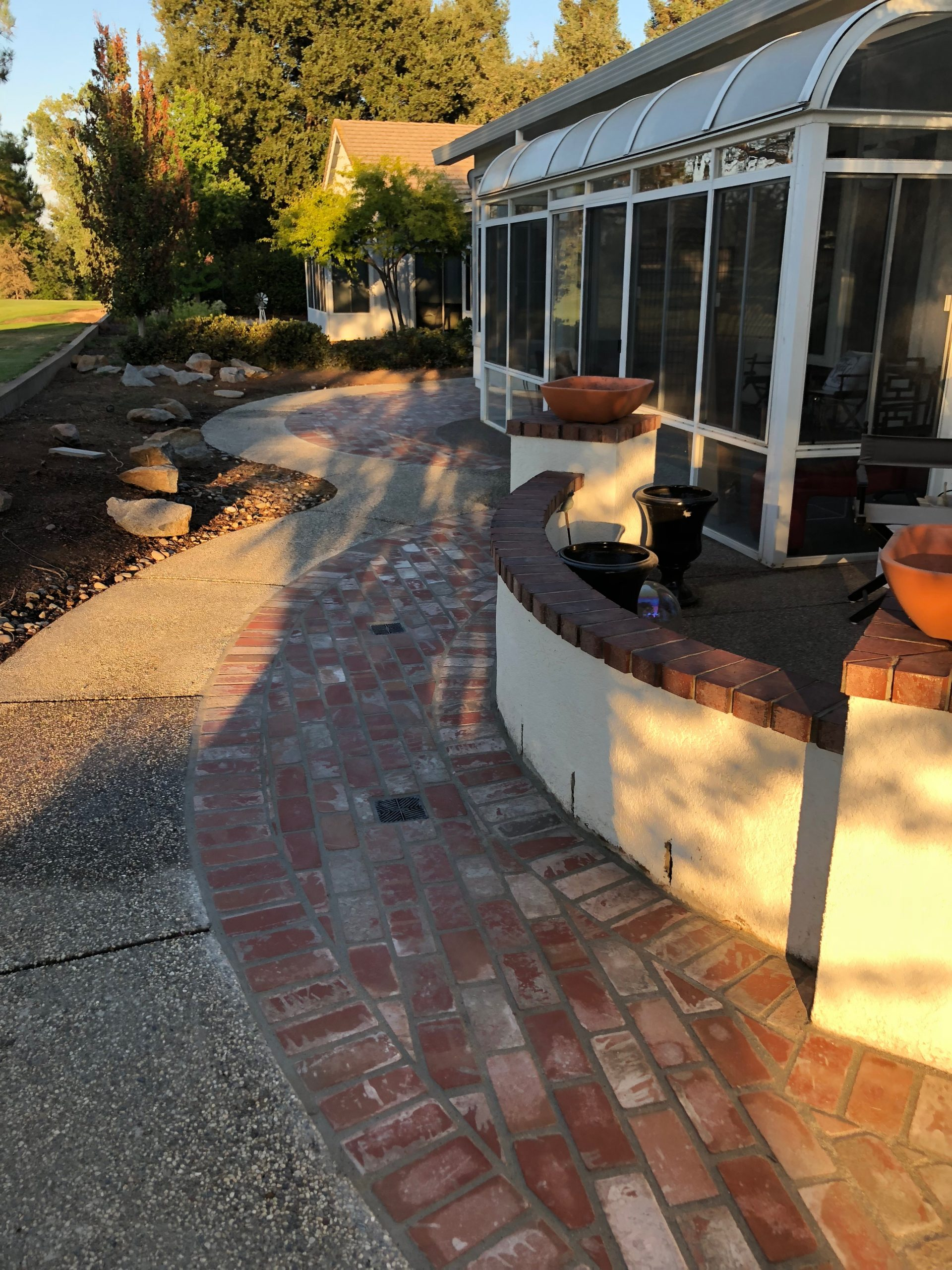 The photo shows the finished concrete work in Pleasanton, CA.